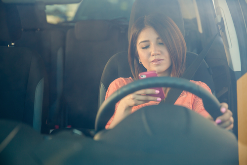 Girl texting while driving