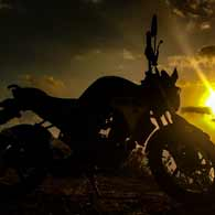A motorcycle at sunset.